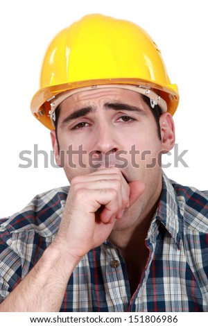 Construction worker yawning