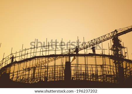 Construction workers and scaffolding