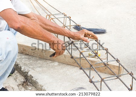 Construction workers are made of steel. - stock photo
