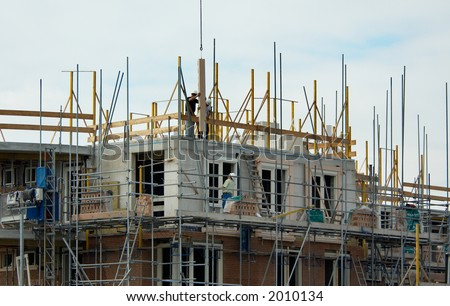 construction workers building a house - stock photo