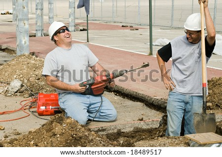 Construction Workers Laughing - stock photo