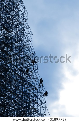 construction workers silhouette - stock photo
