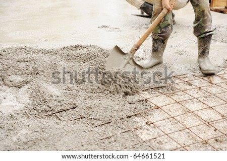 Construction working assemble iron grids into the frame ready for concrete work - stock photo
