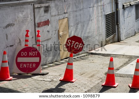 Construction zone with orange cones, stop sign and do not enter siqn