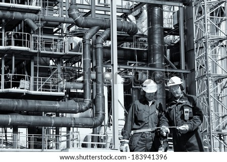 constructions and building workers in light blue toning concept - stock photo