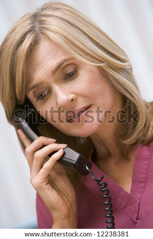 Consultant phoning client from surgery with bad news - stock photo
