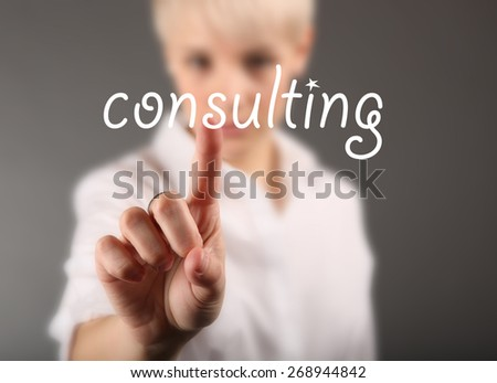 Consultant touching the screen, business concept - stock photo