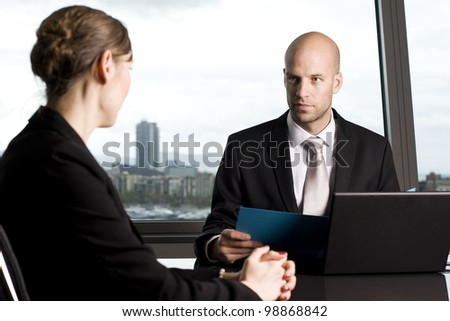 Consultation with male financial adviser in a nice office - stock photo