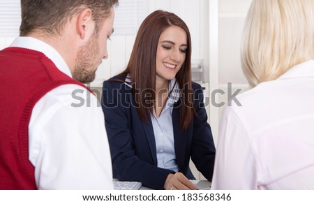 Consultation with young attractive couple at office. - stock photo