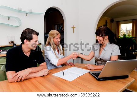 Consulting and contract signature in an apartment - stock photo