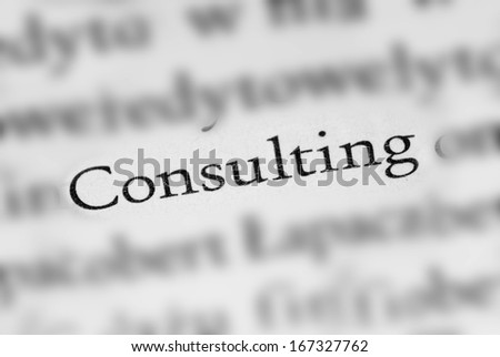 Consulting concept of single word among blurred press article - stock photo