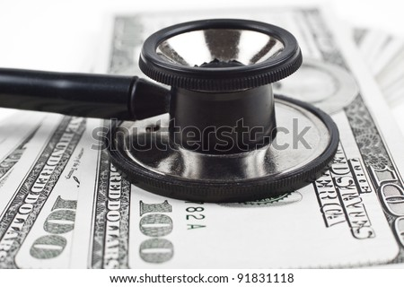 consulting dollars with a black thethoscope close-up on white background - stock photo