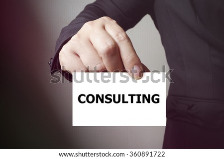 CONSULTING paper on the card , business concept , business idea