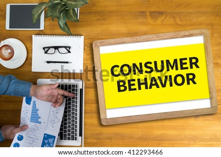 CONSUMER BEHAVIOR Businessman working at office desk and using computer and objects, coffee, top view, - stock photo