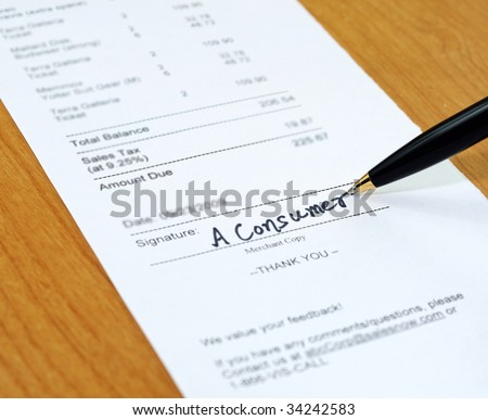 Consumer signing on a sale transaction receipt - stock photo