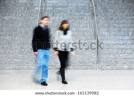 Consumer Walking Up Stairs, Motion Blur