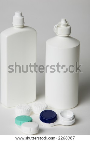 Contact lenses and bottles of fluid - stock photo