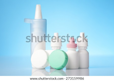 contact lenses in a case and dry eyes eye drops - stock photo