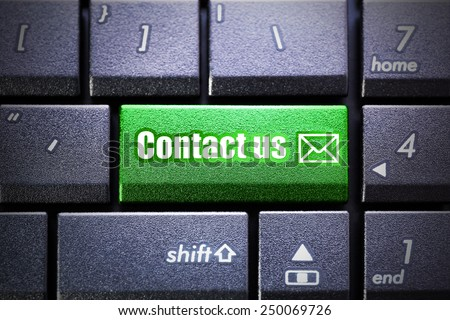 Contact us button on the computer keyboard - stock photo