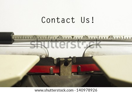 contact us concepts, with message on typewriter paper. - stock photo