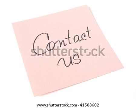 contact us handwritten message on pink sticker - stock photo