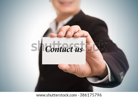 Contact us  message word on card in hand of Friendly man hand and smiling