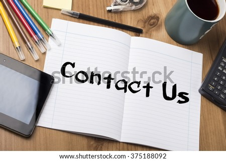 Contact Us - Note Pad With Text On Wooden Table - with office  tools - stock photo