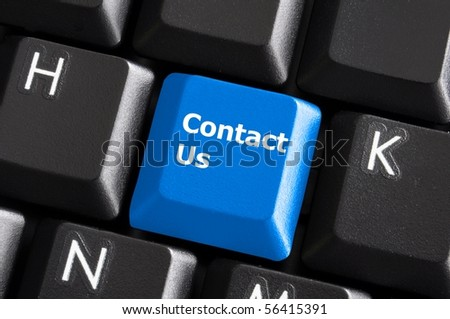 contact us or support concept with computer keyboard button - stock photo