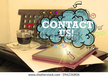 CONTACT US  over the cloud over  tablet on office desk , business concept , business idea , strategy concept - stock photo