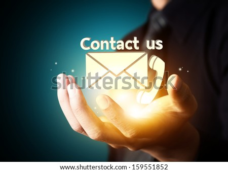 Contact us symbol in businessman hand, Email icon - stock photo