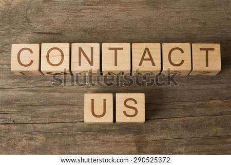 CONTACT US text on a wooden background - stock photo