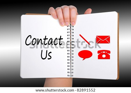 contact us words on book - stock photo