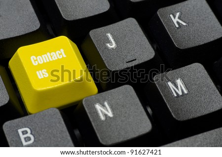 contact us words on yellow and black keyboard button - stock photo