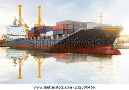 Container Cargo freight ship with working crane bridge in shipyard at Sunrise.edit flares effects . - stock photo