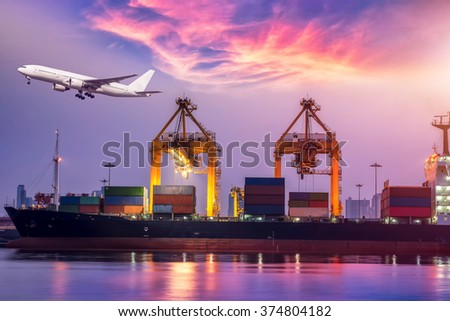 Container Cargo freight ship with working crane bridge in shipyard at sunrise for Logistic Import Export background - stock photo