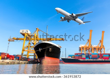 Container cargo freight ship with working crane loading bridge in shipyard for logistic Import export background - stock photo