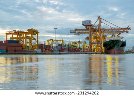 Container Cargo freight ship working crane bridge in shipyard - stock photo