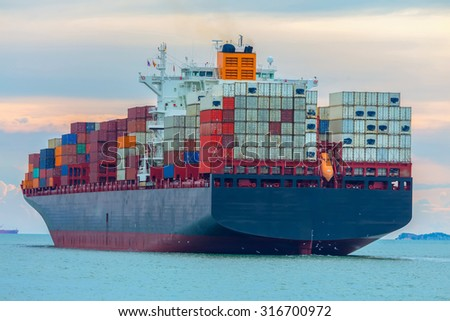 Container cargo ship carrying the tenor in the sea. - stock photo
