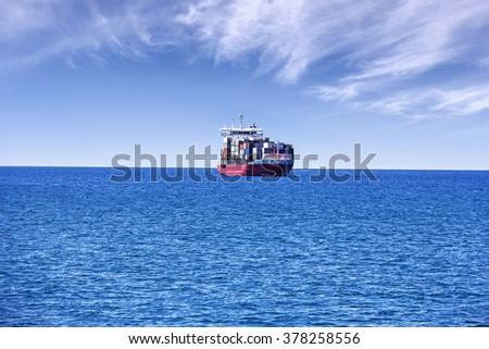 Container cargo ship on the high seas - stock photo
