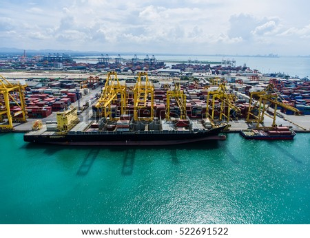 container,container ship in import export and business logistic.By crane , Trade Port , Shipping.Tugboat assisting cargo to harbor.Aerial view.Water transport.International.Shell Marine.Top view.