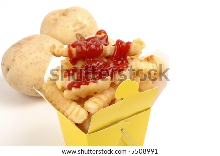 Container fill with golden french fried potatoes.