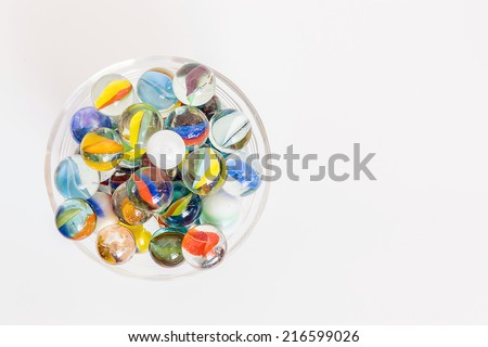 container full of colorful glass balls - stock photo