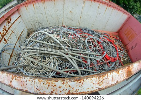 container full of copper electrical cables in a municipal landfill - stock photo