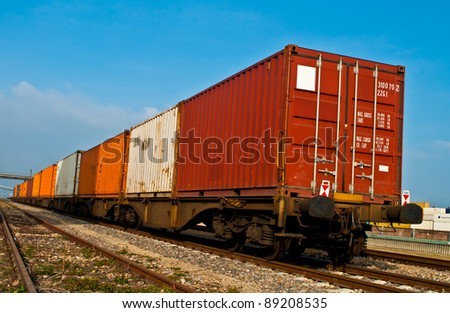 Container loaded on train wagons on a railway - stock photo