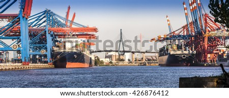 Container Port of Hamburg in the light of the setting sun; Background Koehlbrand Bridge, Northern Germany