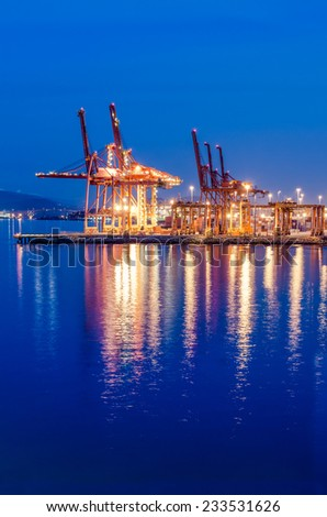 Container port terminal at night, dawn time in Vancouver, Canada. - stock photo