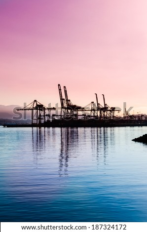 Container port terminal at sunset, sunrise time in Vancouver, Canada. Vertical. - stock photo