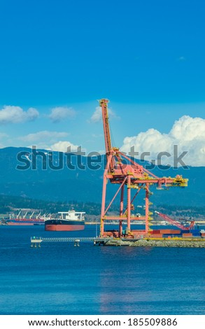Container port terminal in a bright sunny day. Vancouver, Canada. - stock photo