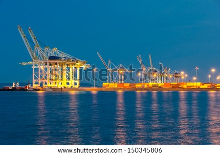 Container port terminal with cranes at sunset, sunrise, dawn time in Vancouver, Canada . - stock photo