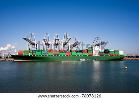 Container ship and cranes in a harbor - stock photo